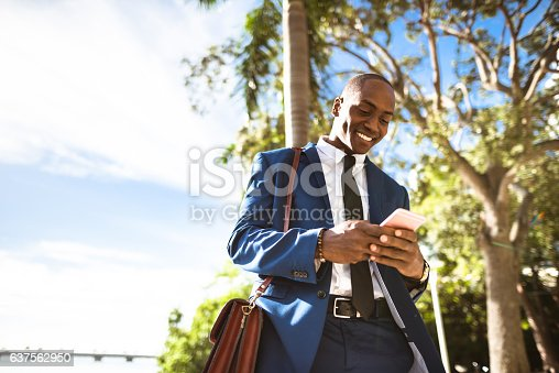 istock businessman texting in miami 637562950