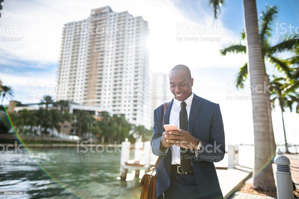 businessman texting in miami stock photo