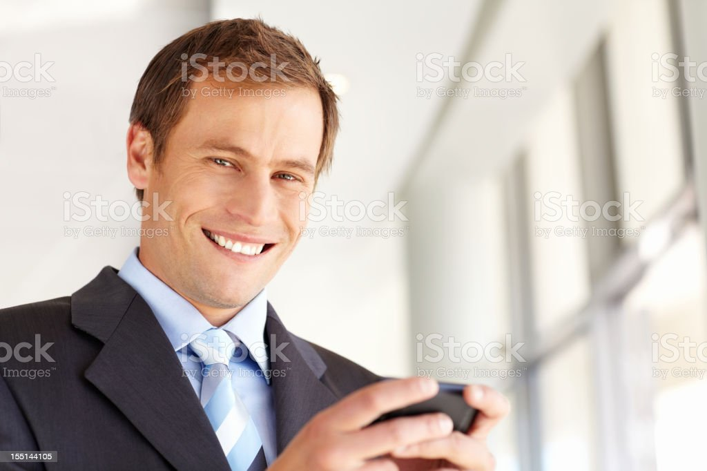 Businessman Texting on a Cellphone royalty-free stock photo