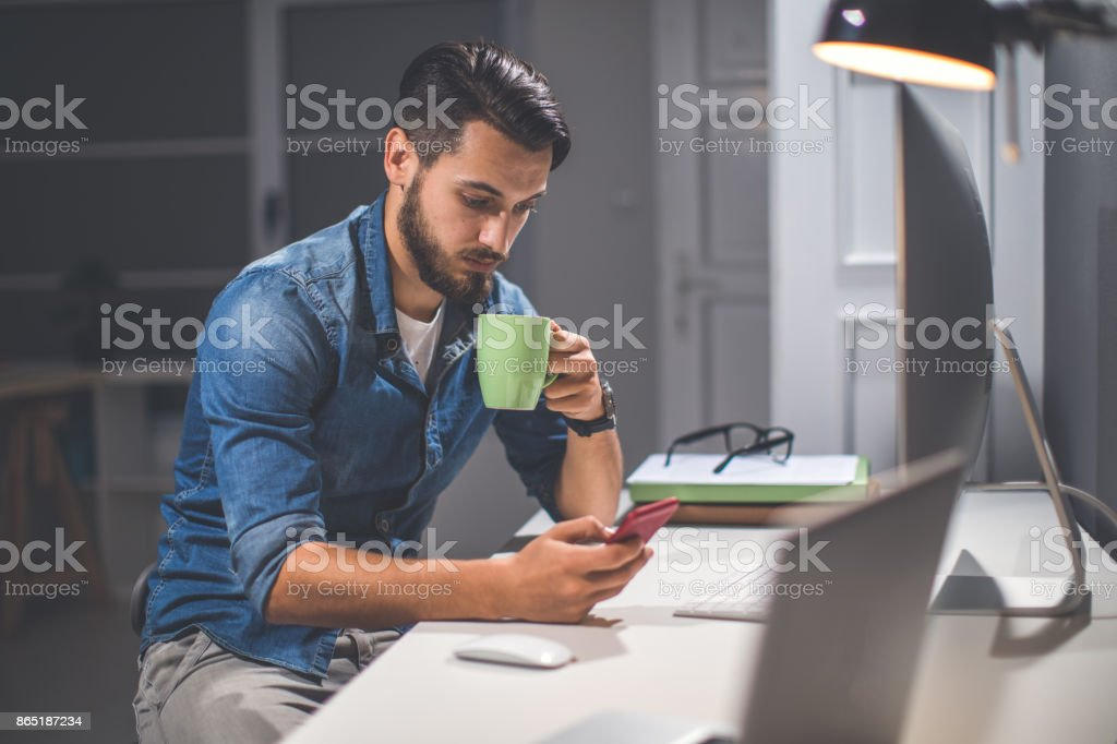 Businessman texting on the phone stock photo