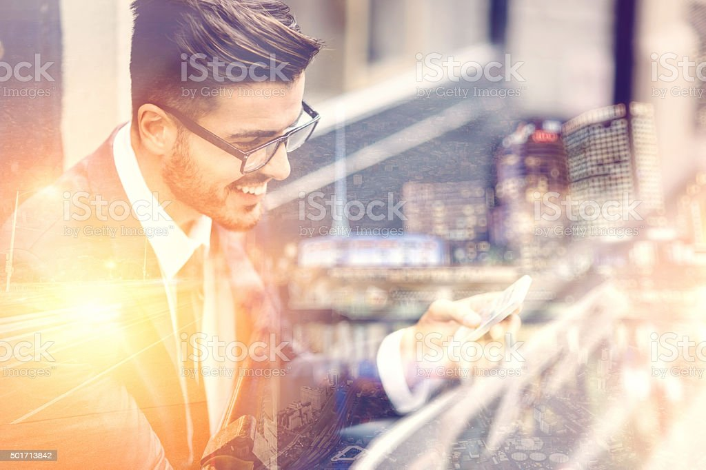 Businessman texting on the street stock photo