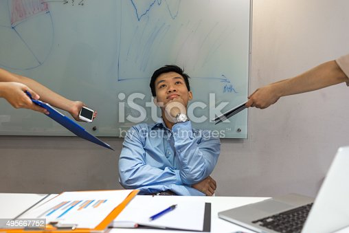 475417253istockphoto Businessman think about vacation although having many works to do 495667752