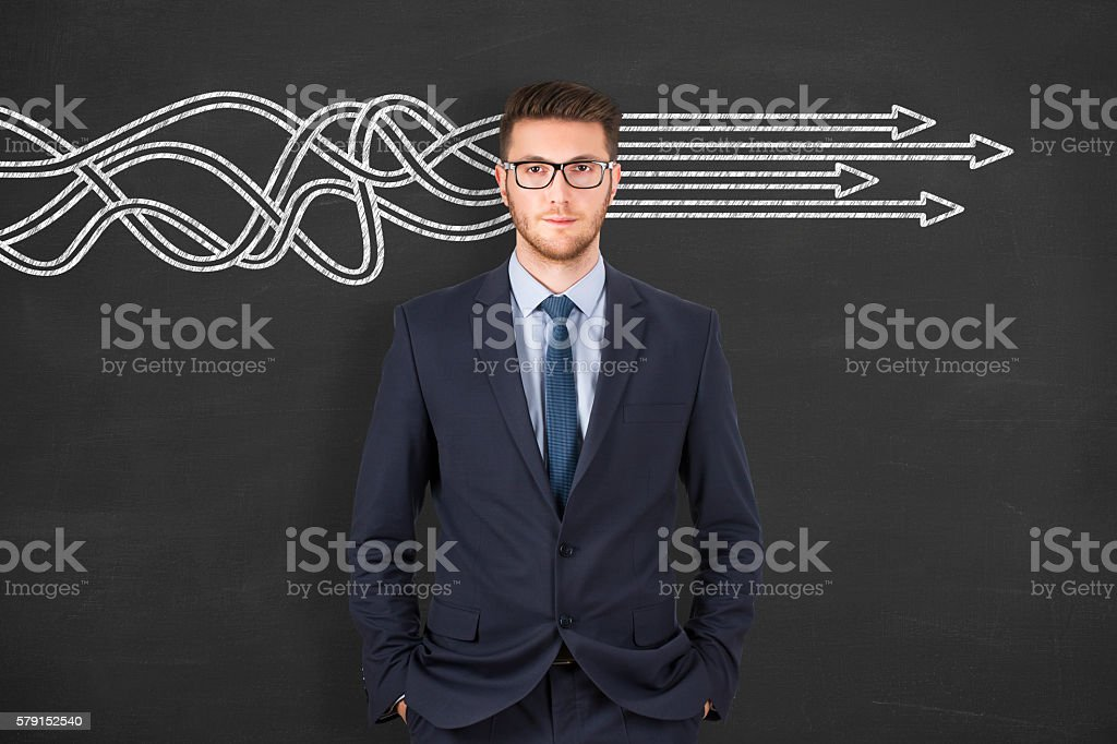 Businessman thinking about structuring business process and solutions concept stock photo