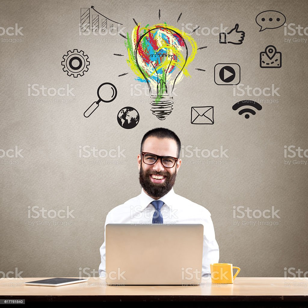 Businessman thinking about the light bulb stock photo