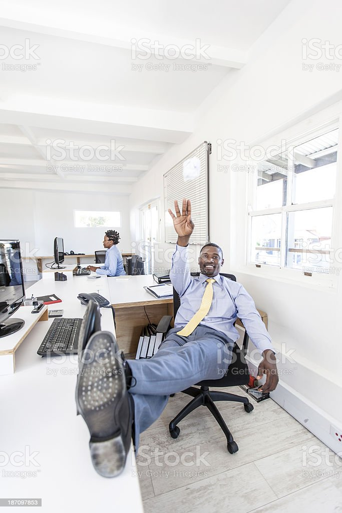 Businessman throwing a ball of crumpled paper in office. stock photo