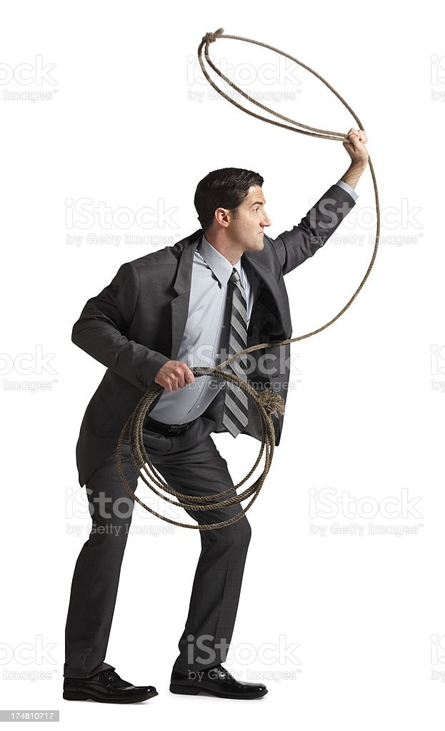 Businessman Throwing a Lasso stock photo