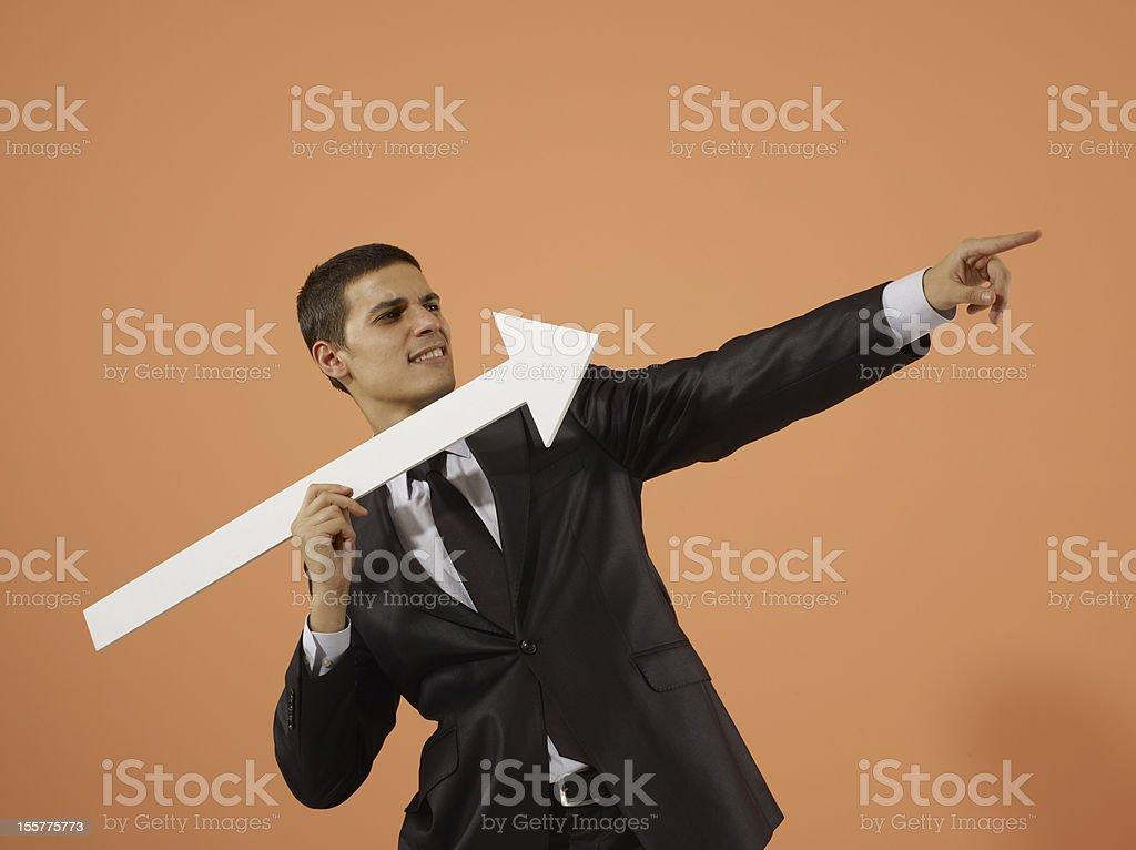 Businessman Throwing Arrow Sign stock photo