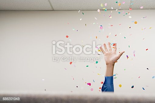 istock Businessman throwing confetti in the air 535201043