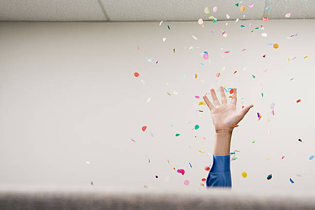 Businessman throwing confetti in the air Businessman throwing confetti in the air leisure equipment stock pictures, royalty-free photos & images