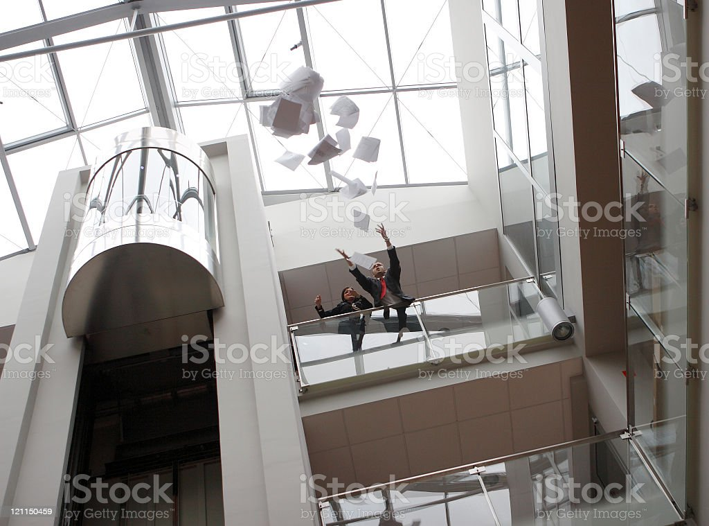 Businessman throwing documents away stock photo