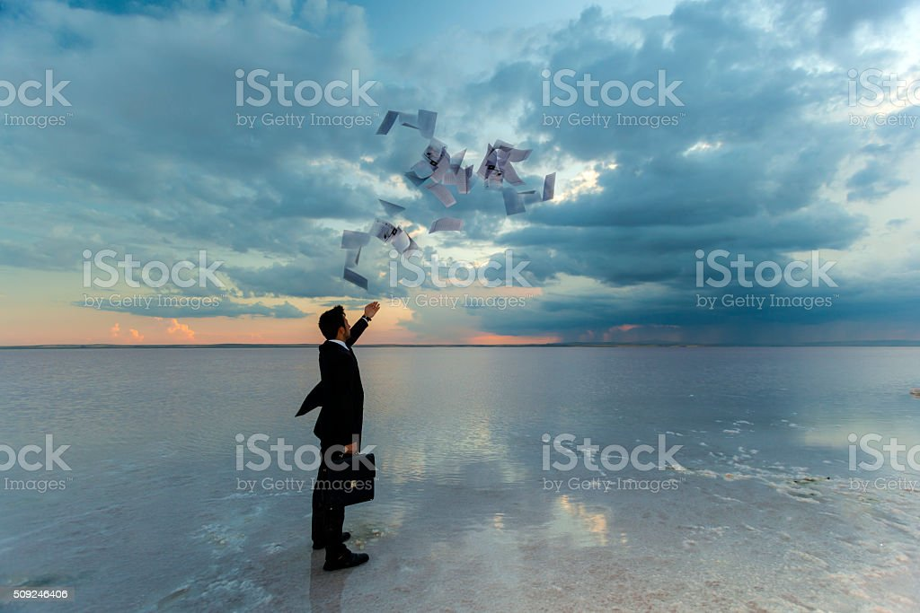 Businessman throwing documents stock photo