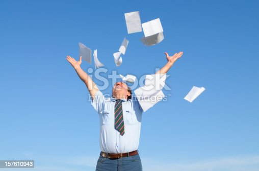 157312920 istock photo Businessman Throwing Papers Blue Sky 157610943