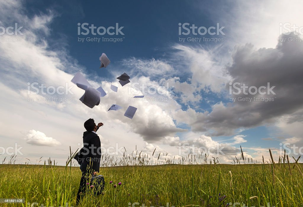 Businessman Throwing Papers in The Air stock photo