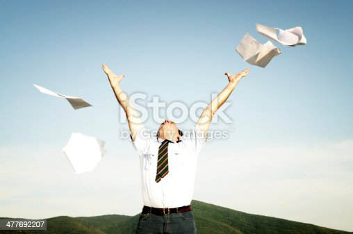 157312920 istock photo Businessman Throwing Papers in the Countryside,Vintage Style. 477692207