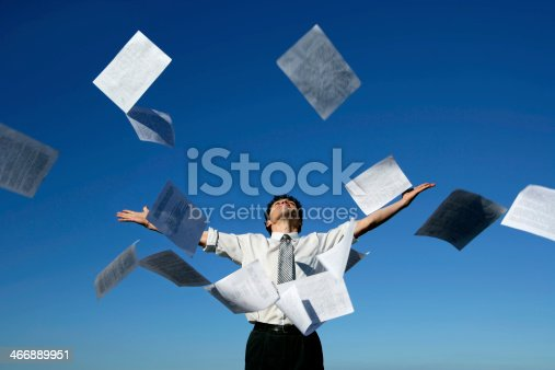 157312920 istock photo Businessman throwing papers into the air 466889951