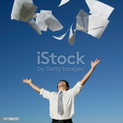 157312920 istock photo Businessman throwing papers 157286252