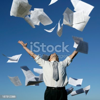 157312920 istock photo Businessman throwing papers 157312395
