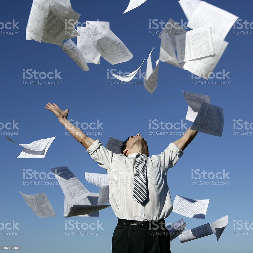 Businessman throwing papers stock photo