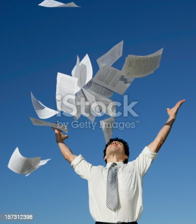 157312920 istock photo Businessman throwing papers 157312398
