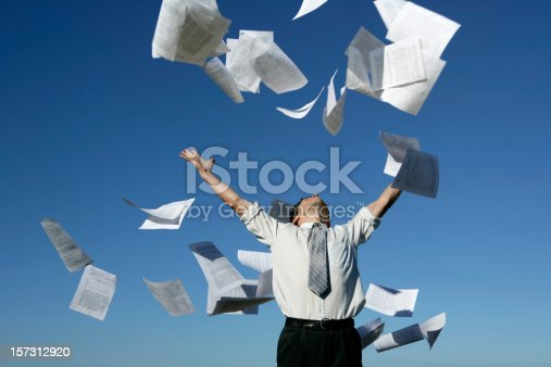 157312920 istock photo Businessman throwing papers 157312920