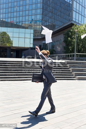 157312920 istock photo Businessman throwing papers 477074092
