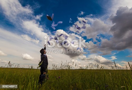 157312920 istock photo Businessman throwing papers 509246912