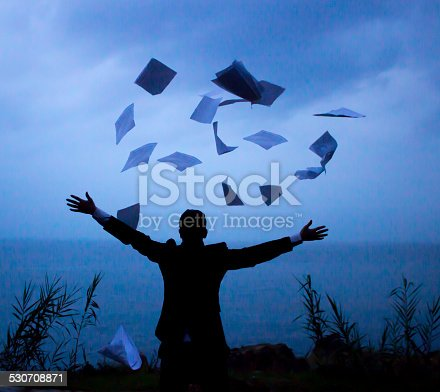 157312920 istock photo Businessman throwing papers 530708871