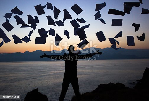 157312920 istock photo Businessman throwing papers 533244923