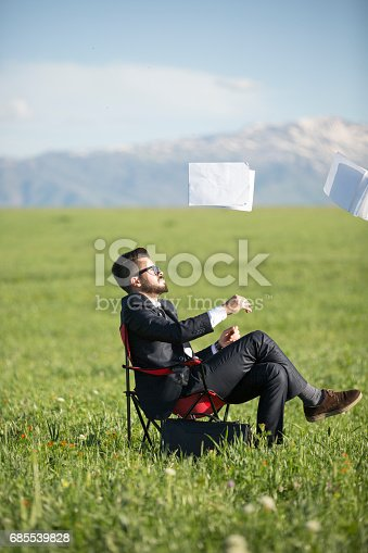 157312920 istock photo Businessman throwing papers 685539828