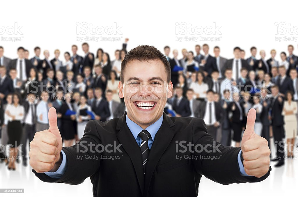 businessman thumb up, big group of businesspeople background stock photo