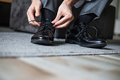 Groom tying shoes, getting ready in the morning
