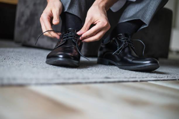 businessman tie shoelaces - men shoes stock pictures, royalty-free photos & images