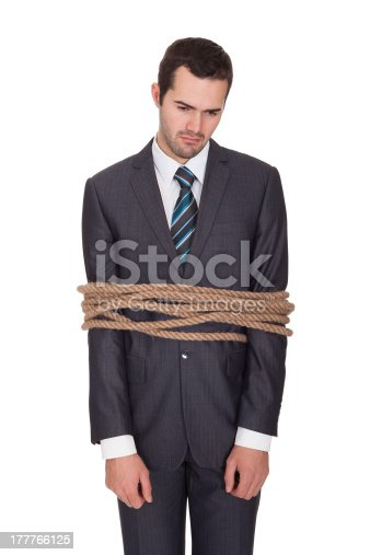 istock Businessman tied up in rope 177766125