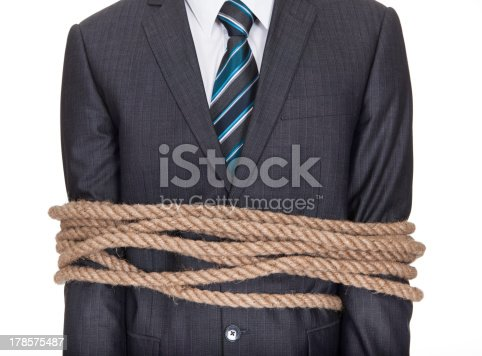 istock Businessman tied up in rope 178575487
