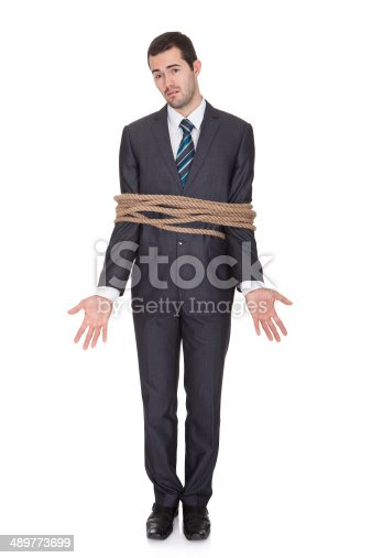 istock Businessman tied up in rope 489773699