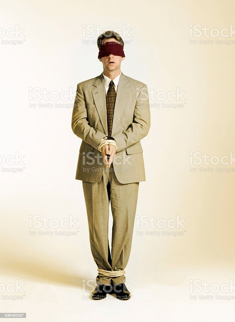 Businessman Tied Up stock photo