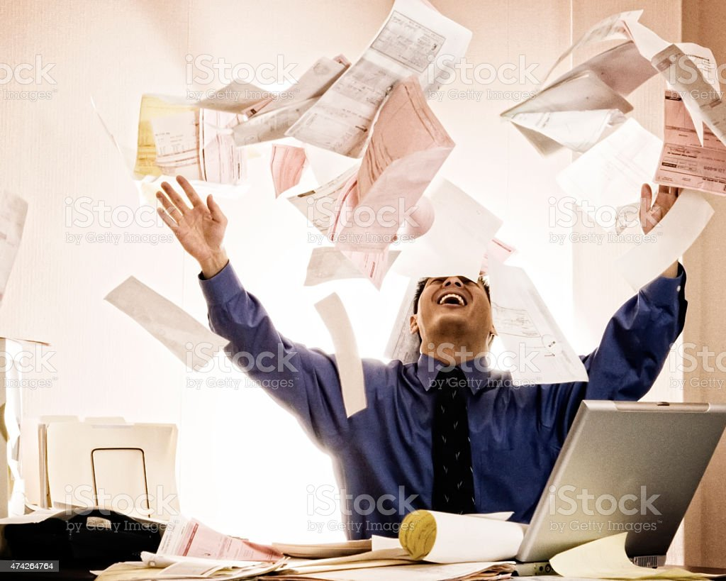 Businessman Tossing Documents. stock photo