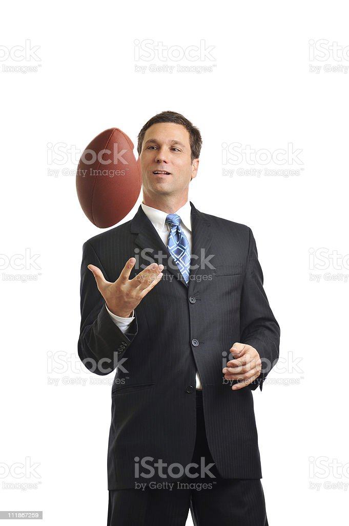 Businessman Tossing Football up on White royalty-free stock photo