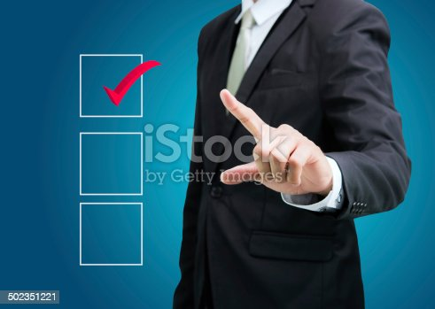 istock businessman touch checking mark checklist marker Isolated 502351221