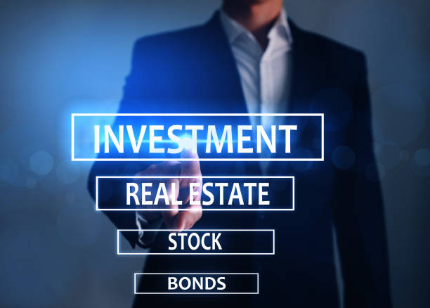 Businessman touch has choose  Investment . Real estate investment concept Business, Internet and technology concept. stock photo