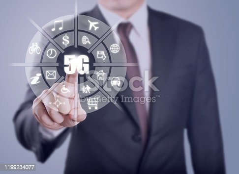 istock Businessman touch infographic of fifth generation wireless technology for digital cellular networks or 5G which it will change high speed of internet and transfer big data of the world. 1199234077