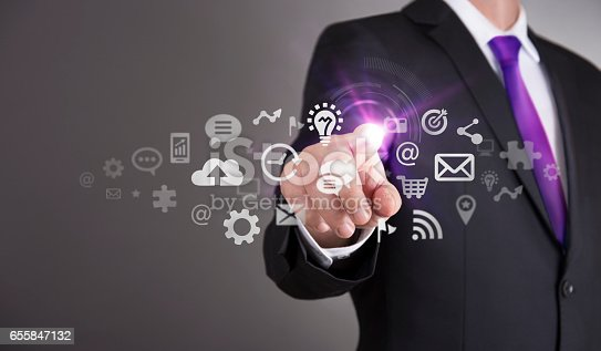 499253490istockphoto Businessman touch screen concept - Networking 655847132