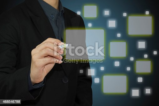 515789546istockphoto Businessman Touch screen concept. 468546788