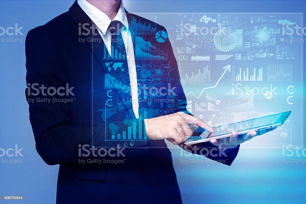 businessman touch screen on tablet stock photo