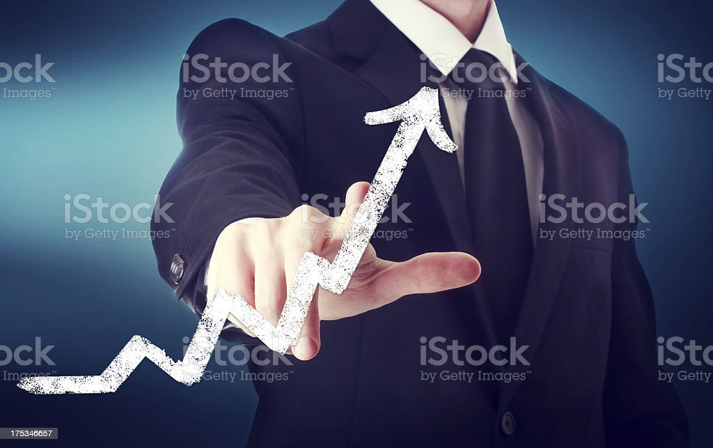 Businessman Touching a Arrow royalty-free stock photo