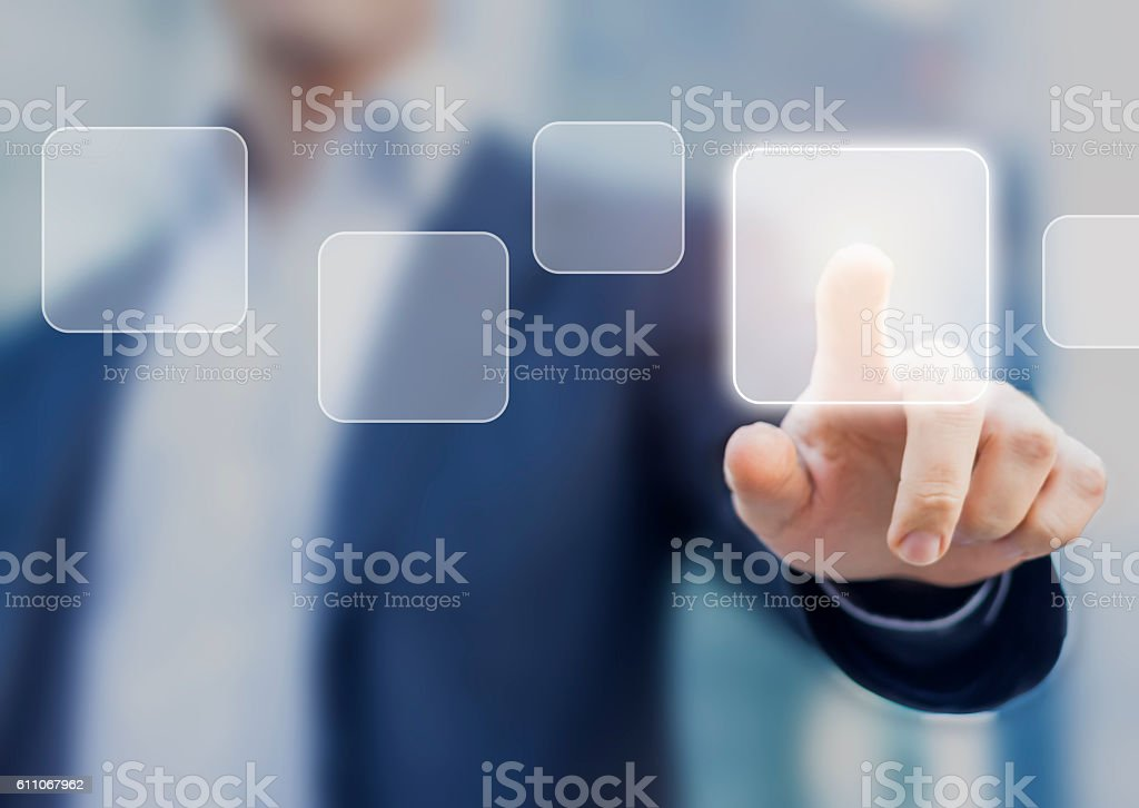 Businessman touching a button on a digital interface screen stock photo