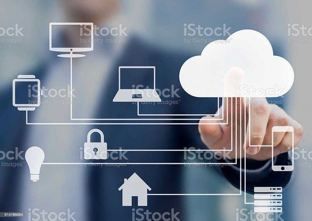 Businessman touching a cloud connected to objects, internet of things stock photo