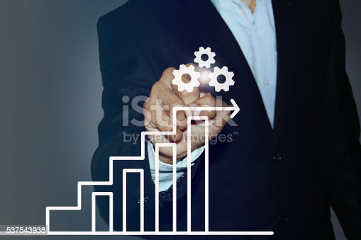 istock Businessman Touching a Graph Indicating Growth 537543938