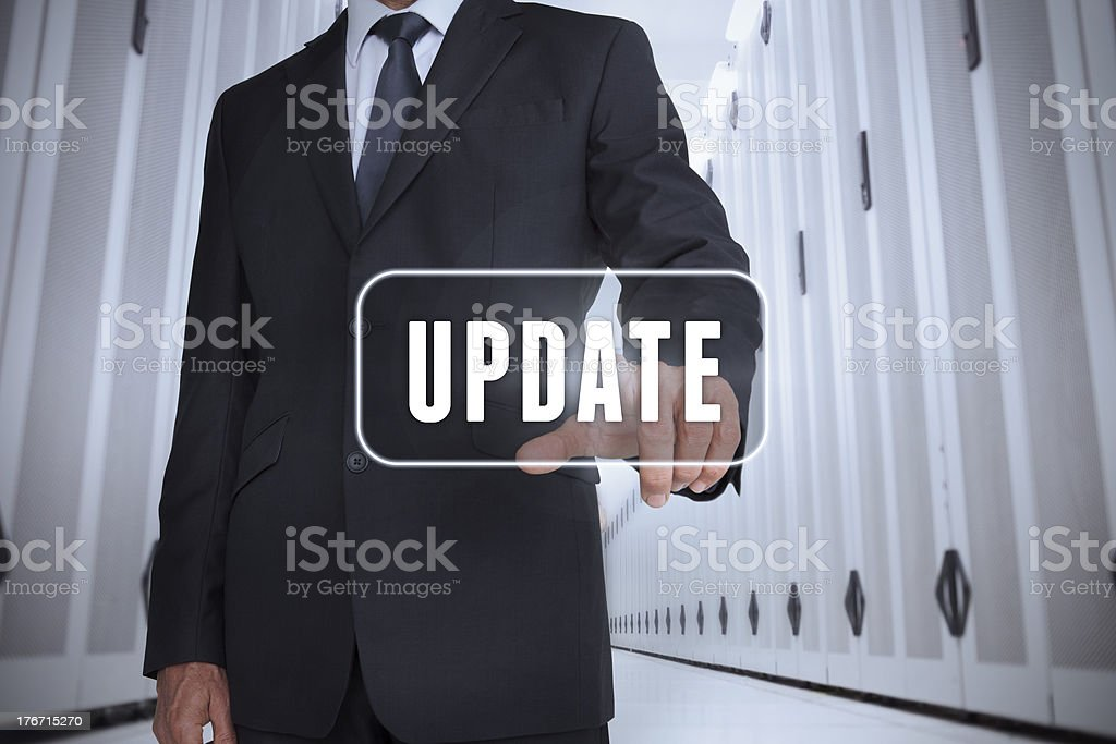 Businessman touching a label with update written on it royalty-free stock photo