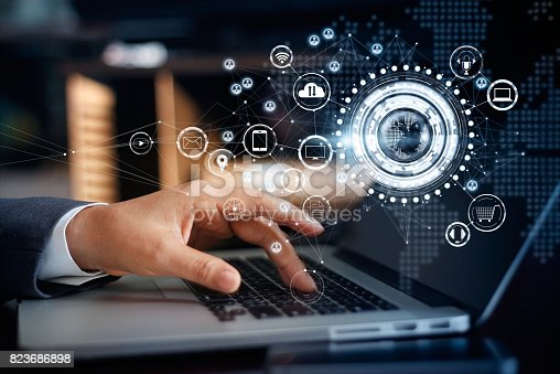 istock Businessman touching a laptop on global network connection, Omni Channel and communications concept 823686898